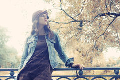Fashion model posing in summer park Royalty Free Stock Photography