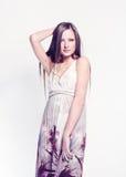 Fashion model posing on white background in the studio. Royalty Free Stock Photos
