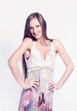Fashion model posing on white background in the studio. Stock Photo