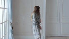 Fashion model posing in white interior stock video