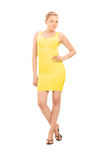 Fashion model posing in a yellow dress Stock Photos