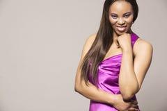 Fashion model in purple dress. Royalty Free Stock Image