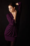 Fashion model in purple mini dress Royalty Free Stock Images