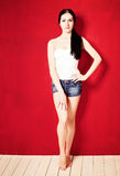 Fashion Model on Red Background Stock Photos