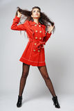 Fashion model in red coat. Royalty Free Stock Photos