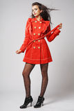 Fashion model in red coat. Stock Photography