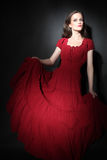 Fashion model in red dress Elegant woman Royalty Free Stock Photography