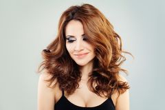 Fashion Model with Red Hair Looking Down Royalty Free Stock Photos