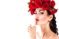 Fashion model with red roses hairstyle Stock Images