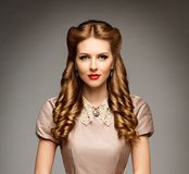 Fashion Model Retro Hairstyle, Elegant Woman Old Fashioned Curly Hair Style, Young Girl Beauty Portrait. Over studio gray background stock photography