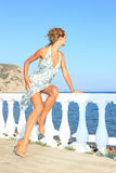 Fashion model by the sea in Greece Stock Images