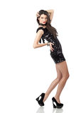 Fashion model in sequin dress. Attractive young woman posing in sequin dress, looking away. Studio image,  on white background Stock Photos