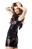 Fashion model in sequin dress. Attractive, happy  young woman posing in sequin dress, looking at camera. Studio image, isolated on white background Royalty Free Stock Image