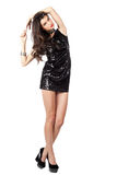 Fashion model in sequin dress. Attractive young woman posing in sequin dress, looking at camera. Studio image, isolated on white background Royalty Free Stock Photography