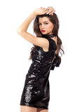 Fashion model in sequin dress. Attractive young woman posing in sequin dress, looking at camera. Studio image, isolated on white background Stock Photo