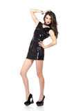 Fashion model in sequin dress. Attractive young woman posing in sequin dress, looking at camera. Studio image,  on white background Stock Image