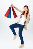 Fashion model with shopping bag. Isolated white background full Royalty Free Stock Image