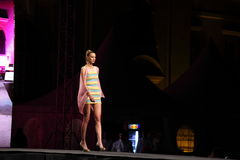 Fashion model with a short dress. Sibiu, Romania - June 1, 2013: Sibiu Fashion Days 2013. Young fashion designers presenting cloths in Grande Square, Sibiu Stock Image
