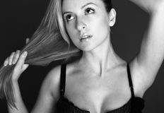 Fashion model with shoulders in her hand. Royalty Free Stock Photography