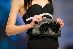 Fashion model shows bag from Benvenuti Royalty Free Stock Image