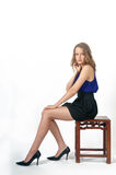Fashion model sitting Royalty Free Stock Images