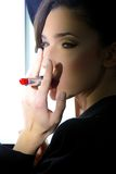 Fashion model smoking red lipstick Stock Photography