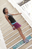 Fashion model in the stairs Royalty Free Stock Image