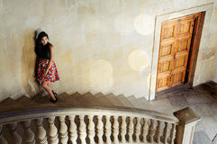 Fashion model in stairs. Fashion model with designer dress at the Charles V Palace in Alhambra, Granada, Spain Royalty Free Stock Image
