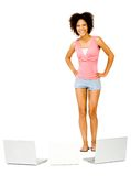 Fashion model standing near laptops Stock Image