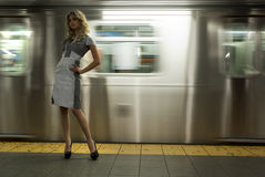 Fashion model standing at NYC subway Stock Photo