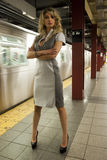 Fashion model standing at NYC subway Stock Photography