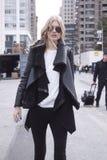 Fashion model Street Style wearing aviator sunglasses during Fashion Week Stock Photos