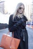 Fashion model Street Style wearing aviator sunglasses and orange handbag  during Fashion Week Royalty Free Stock Photos