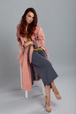 Fashion Model Style. Fashionable Woman Posing In Studio Stock Photo