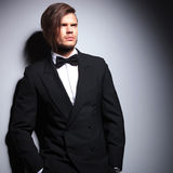 Fashion model in suit with bow tie looking away Royalty Free Stock Image