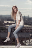 Fashion model. Summer look. Jeans, sneakers, sweater. Royalty Free Stock Photos