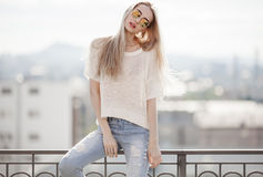 Fashion model. Summer look. Jeans, sweater, sunglasses. Royalty Free Stock Images
