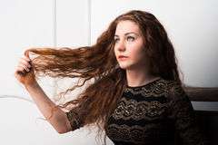 Fashion model touch her perfect long ginger hair Royalty Free Stock Photo