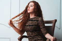 Fashion model touch her red hair Royalty Free Stock Photos
