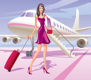 Fashion model traveling by aircraft Stock Image