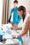 Fashion model trying jacket in designer studio Stock Photos