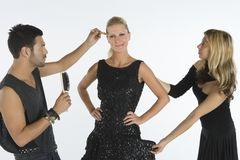 Fashion Model With Two Artist Assisting Her Stock Images