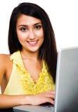 Fashion model using a laptop Royalty Free Stock Photo