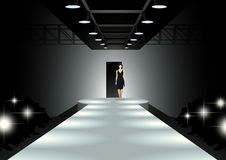 Fashion model walking down the catwalk Royalty Free Stock Photo