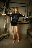 Fashion model in water supply room Stock Photography