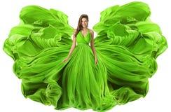 Fashion Model Waving Dress as Wings, Woman Green Gown Fabric stock photo