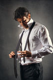 Fashion model wearing a black tie royalty free stock photography