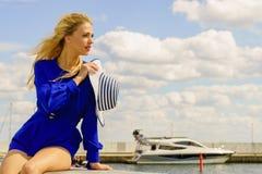 Fashion model wearing blue jumpsuit. Fashionable woman wearing blue jumpsuit shorts perfect for summer holding elegant stylish sun hat. Fashion model outdoor Royalty Free Stock Photos