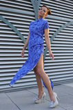Fashion model wearing blue long dress Royalty Free Stock Image