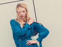 Fashion model wearing blue navy shirt. Fashionable woman wearing blue navy shirt perfect for summer. Fashion model outdoor photo shoot stock images